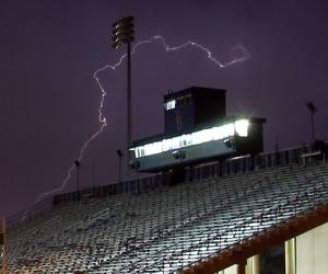 A severe storm made its way through Delaware this evening, dropping the temperature after a hot and humid day. A high of 93 in Georgetown broke a record. Here's a photo by News Journal photographer William Bretzger of lightning striking at the UD football stadium. That game against DSU was postponed until tomorrow at noon.